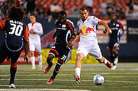 Jorge Rojas (13) of the New York Red Bulls plays the ball while marked by Sainey Nyassi (31) of the New England Revolution. The New York Red Bulls and the New England Revolution played to a 1-1 tie during a Major League Soccer match at Giants Stadium in East Rutherford, NJ, on September 18, 2009.