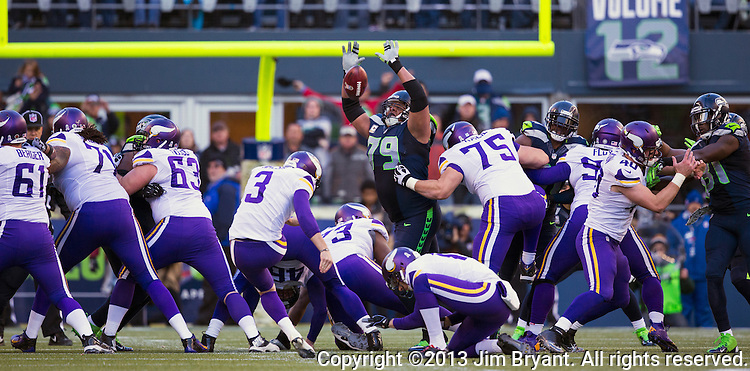 Seattle Seahawks  Minnesota Vikings kicker Blair Walsh kicks a 32 yard field goal against the Seahawks at CenturyLink Field in Seattle, Washington on  November 17, 2013.  The Seahawks beat the Vikings 41-20.  ©2013.  Jim Bryant. All Rights Reserved.