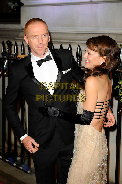 Damian Lewis &amp; Helen McCrory <br /> attending the BFI Luminous Gala Dinner, 8 Northumberland Avenue, London, England. <br /> 8th October 2013<br /> half length black tuxedo gloves beige side profile shaved head dress married husband wife <br /> CAP/MAR<br /> &copy; Martin Harris/Capital Pictures
