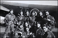 BNPS.co.uk (01202 558833)<br /> Pic: Bellmans/BNPS<br /> <br /> Lance Corporal William James Cooke (far left) with his squadron about to go off on another mission.<br /> <br /> A fascinating trove of SAS records including some of the first photographs of the elite force which have never been seen before has been unearthed. <br /> <br /> The extensive assortment, also including medals and documents, was accumulated by war hero Lance Corporal William James Cooke at the end of World War Two. <br /> <br /> Remarkable images of Cooke's previously unrevealed wartime exploits show him serving behind enemy lines in occupied France and assisting with the liberation of Norway. <br /> <br /> His accomplishments have come to light after a family member presented the bequeathed collection to Hampshire-based auctioneer Bellmans, which will sell it tomorrow.