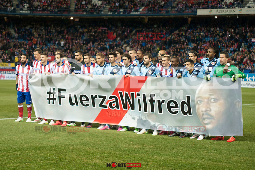 Atletico de Madrid&acute;s and Rayo Vallecano&acute;s players make a tribute to Wilfred during 2014-15 La Liga match between Atletico de Madrid and Rayo Vallecano at Vicente Calderon stadium in Madrid, Spain. January 24, 2015. (ALTERPHOTOS/Luis Fernandez) /NortePhoto<br />