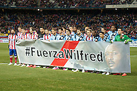 Atletico de Madrid´s and Rayo Vallecano´s players make a tribute to Wilfred during 2014-15 La Liga match between Atletico de Madrid and Rayo Vallecano at Vicente Calderon stadium in Madrid, Spain. January 24, 2015. (ALTERPHOTOS/Luis Fernandez) /NortePhoto<br /> NortePhoto.com