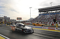 Apr. 5, 2013; Las Vegas, NV, USA: NHRA funny car driver Cruz Pedregon (near lane) races alongside Del Worsham during qualifying for the Summitracing.com Nationals at the Strip at Las Vegas Motor Speedway. Mandatory Credit: Mark J. Rebilas-