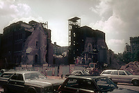 The demolition of The Church of St. Alphonsus Liguori on West Broadway in the New York neighborhood of Soho is seen in August 1981.The Church of St. Alphonsus Liguori was a parish for German Catholics established in 1847 by the Redemptorist Fathers. Designed in Lombard Romanesque style by Francis G. Hempler, the building was constructed between 1870-72 . In 1980, the church building has finally settled into the bed of an underground stream and was closed. It was razed the following year with The Soho Grand Hotel now occupying the site. (© Frances M. Roberts)