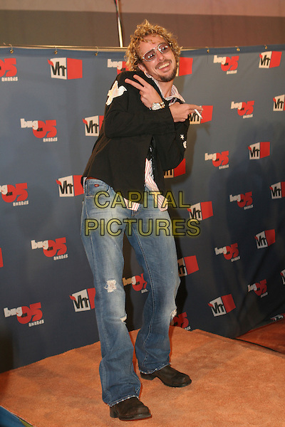 "JOHNNY FAIRPLAY.""VH1 Big In '05 Awards"" - Arrivals held at Sony Studios, Culver City, California..December 3rd, 2005.Photo: Zach Lipp/AdMedia/Capital Pictures.Ref: ZL/ADM.full length posing hand gesture jeans denim peace v sign.www.capitalpictures.com.sales@capitalpictures.com.© Capital Pictures."
