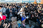 Photographers take pictures of a cosplayer during the ''Comic Market (Comiket) 89'' at Tokyo Big Sight on December 29, 2015, Tokyo, Japan. Thousands of comic, game and cosplay fans attended the first day of the world's biggest amateur comic fair. Established in 1975, the bi-annual event provides an opportunity for fans and artists to interact. The exhibition is held from December 29 to 31 and expected to attract over 500,000 visitors. (Photo by Rodrigo Reyes Marin/AFLO)