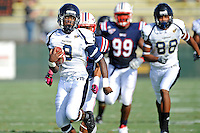 30 October 2010:  FIU running back Kedrick Rhodes (9) carries the ball on a long run in the first quarter as the Florida Atlantic University Owls defeated the FIU Golden Panthers, 21-9, at Lockhart Stadium in Fort Lauderdale, Florida.