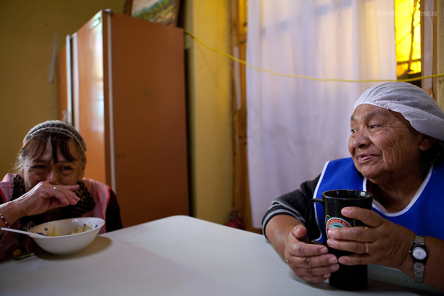 Luppe (L) and Conchita (R), both residents of Casa Xochiquetzal, during lunch time at the shelter in Mexico City, Mexico on October 4, 2010. Casa Xochiquetzal is a shelter for elderly sex workers in Mexico City. It gives the women refuge, food, health services, a space to learn about their human rights and courses to help them rediscover their self-confidence and deal with traumatic aspects of their lives. Casa Xochiquetzal provides a space to age with dignity for a group of vulnerable women who are often invisible to society at large. It is the only such shelter existing in Latin America. Photo by Bénédicte Desrus
