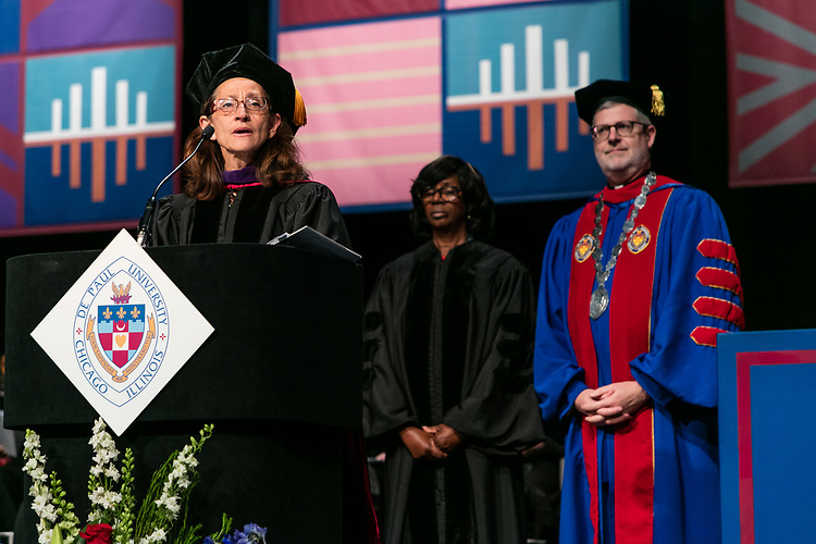 Jennifer Rosato Perea, dean of the College of Law, awards an honorary degree to labor and employment attorney Paulette Brown with the Rev. Dennis H. Holtschneider, C.M., president of DePaul, during the College of Law commencement ceremony, Sunday, May 14, 2017. The ceremony was held at the Rosemont Theatre in Rosemont, IL, where some 240 students received their Juris Doctors or Master of Laws degrees. (DePaul University/Jeff Carrion)