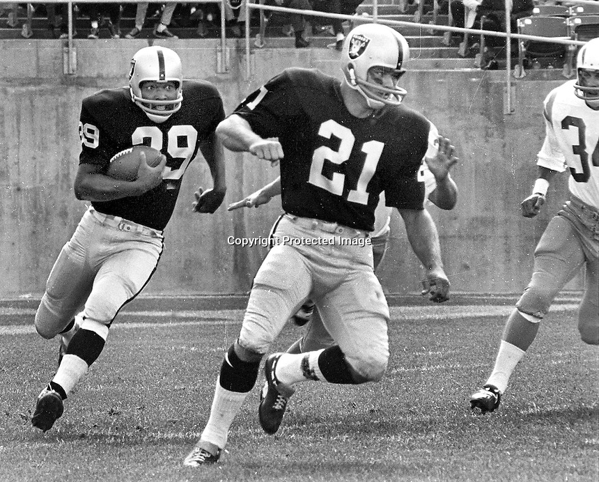 Oakland Raiders Pervis Atkins #39 with #21 Roger Bird blocking against the Chargers (1966 photo by Ron Riesterer)