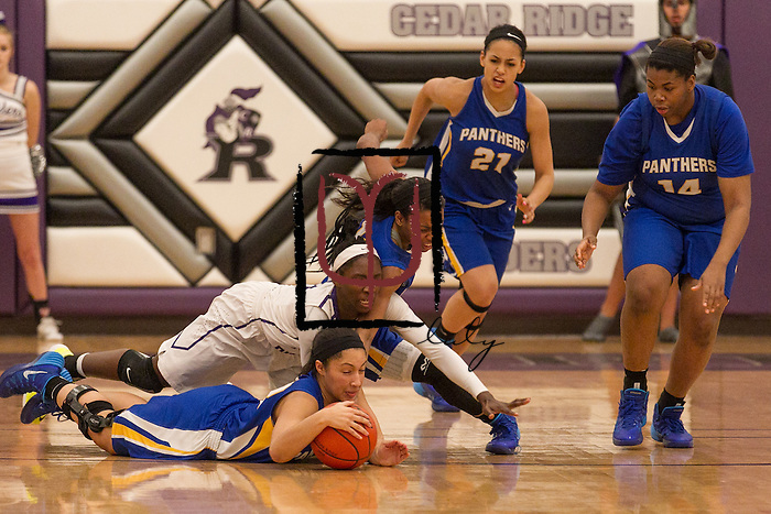 Pflugerville's Alyssa Washington steals the ball from Cedar Ridge's Lashann Higgs Friday at Cedar Ridge.  The Panthers beat the Raiders 70-66.  (LOURDES M SHOAF for Round Rock Leader.)