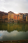 Florence, Italy, reflection across the Arno river with buildings in background