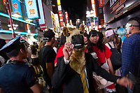 A man puts a cigarette up to his horse head mask during the Halloween celebrations Shibuya, Tokyo, Japan. Saturday October 27th 2018. The celebrations marking this event have grown in popularity in Japan recently. Enjoyed mostly by young adults who like to dress up, drink , dance and misbehave in parts of Tokyo like Shibuya and Roppongi. There has been a push back from Japanese society and the police to try to limit the bad behaviour.