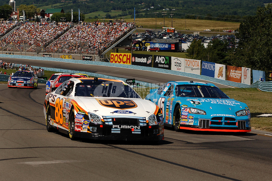 Aug. 13, 2006; Watkins Glen, NY, USA; Nascar Nextel Cup driver Dale Jarrett (88) races Kyle Petty (45) during the AMD at the Glen at Watkins Glen International. Mandatory Credit: Mark J. Rebilas