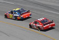 May 6, 2007; Richmond, VA, USA; Nascar Nextel Cup Series driver Jeff Gordon (24) leads Dale Earnhardt Jr (8) during the Jim Stewart 400 at Richmond International Raceway. Mandatory Credit: Mark J. Rebilas