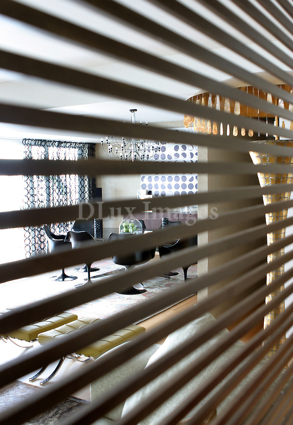 contemporary dining room as shown through blinds