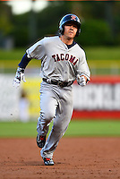 Daniel Robertson (2) of the Tacoma Rainiers hustles towards third base against the Salt Lake Bees in Pacific Coast League action at Smith's Ballpark on June 13, 2016 in Salt Lake City, Utah. Tacoma defeated Salt Lake 3-1.  (Stephen Smith/Four Seam Images)