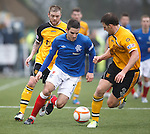 Andy Little driving for goal