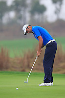 Richard Bland (ENG) putts on the 14th green during Friday's Round 2 of the 2014 BMW Masters held at Lake Malaren, Shanghai, China 31st October 2014.<br /> Picture: Eoin Clarke www.golffile.ie