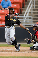 Quincy Latimore #22 of the West Virginia Power follows through on his swing versus the Hickory Crawdads at L.P. Frans Stadium June 21, 2009 in Hickory, North Carolina. (Photo by Brian Westerholt / Four Seam Images)