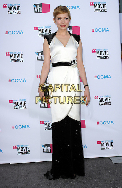 Michelle Williams.17th Annual Critics Choice Movie Awards held at the Hollywood Palladium, Los Angeles, California, USA..January 12th, 2012.full length white dress black maxi belt wrap clutch bag.CAP/ADM/KB.©Kevan Brooks/AdMedia/Capital Pictures.