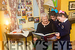 Mary Melvin, Grandmother to Jessica and Adel Hanlon, Manor Tralee reads to them   at the Caherleaheen NS Grandparents Day on Friday