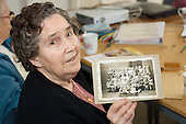 Madge Davison with a photograph of herself at East Row School in 1930.  Open Age reminiscence session at the WECH Community Centre, Paddington, London.