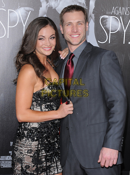 Ashley Ann Vickers, Jake Pavelka.The L.A Premiere of 'This Means War' held at The Grauman's Chinese Theatre in Hollywood, California, USA..February 8th, 2012.half length black lace dress grey gray suit jacket red tie couple .CAP/RKE/DVS.©DVS/RockinExposures/Capital Pictures.