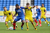 Anthony Grant of Peterborough United (left) and Ryan Ledson of Oxford United battle during the Sky Bet League 1 match between Peterborough and Oxford United at the ABAX Stadium, London Road, Peterborough, England on 30 September 2017. Photo by David Horn.