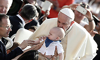 Papa Francesco bacia un bambino al suo arrivo all'udienza generale del mercoledi' in Piazza San Pietro, Citta' del Vaticano, 30 agosto, 2017.<br /> Pope Francis kisses a baby as he arrives to lead his weekly general audience in St. Peter's Square at the Vatican on August 30, 2017.<br /> UPDATE IMAGES PRESS/Isabella Bonotto<br /> <br /> STRICTLY ONLY FOR EDITORIAL USE