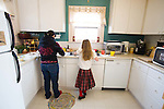 Margaret B. Jones preparing enchiladas with her daughter Rya Hickey in Margaret's kitchen in Eugene, Oregon