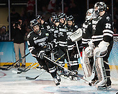 Kyle McKenzie (PC - 5), Jon Gillies (PC - 32) - The Providence College Friars defeated the Boston University Terriers 4-3 to win the national championship in the Frozen Four final at TD Garden on Saturday, April 11, 2015, in Boston, Massachusetts.