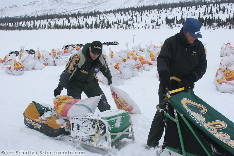 Jeff King loads food drop bags on his sled at Rainy Pass, 2008. Photo by Jon Little.
