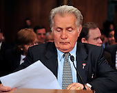 """Actor Martin Sheen looks over his notes as he prepares to testify during a hearing before the United States Senate Committee on the Judiciary Subcommittee on Crime and Terrorism on """"Drug and Veterans Treatment Courts: Seeking Cost-Effective Solutions for Protecting Public Safety and Reducing Recidivism"""" in Washington, D.C. on Tuesday, July 19, 2011..Credit: Ron Sachs / CNP"""