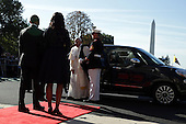 Pope Francis exits his car to greet the U.S. President Barack Obama and first Lady Michelle Obama in an arrival ceremony at the White House on September 23, 2015 in Washington, DC. The Pope begins his first trip to the United States at the White House followed by a visit to St. Matthew's Cathedral, and will then hold a Mass on the grounds of the Basilica of the National Shrine of the Immaculate Conception. <br /> Credit: Alex Wong / Pool via CNP