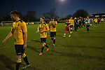 The payers leaving the pitch at the final whistle at Lye Meadow as Alvechurch (in amber) hosted Highgate United in a Midland Football League premier division match. Originally founded in 1929 and reformed in 1996 after going bust, the club has plans to move from their current historic ground to a new purpose-built stadium in time for the 2017-18 season. Alvechurch won this particular match by 3-0, watched by 178 spectators, taking them back to the top of the league.