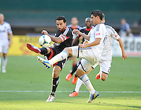 Dwayne De Rosario (7) of D.C. United goes against Johnny Leveron (16) of the Vancouver Whitecaps FC. The Vancouver Whitecaps FC defeated D.C. United 1-0, at RFK Stadium, Saturday June 29 , 2013.