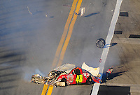 Feb 6, 2010; Daytona Beach, FL, USA; Pieces fly from the car of ARCA RE/MAX Series driver Jill George (48) after she crashed during the Lucas Oil Slick Mist 200 at Daytona International Speedway. Mandatory Credit: Mark J. Rebilas-