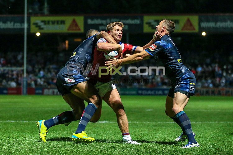 Picture by Alex Whitehead/SWpix.com - 10/08/2017 - Rugby League - Betfred Super League - Wakefield Trinity v Leeds Rhinos - Beaumont Legal Stadium, Wakefield, England - Wakefield's Kyle Wood is tackled by Leeds' Kallum Watkins and Danny McGuire.