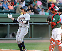 Infielder Dante Bichette Jr. (19) of the Charleston RiverDogs claps his hands after hitting hot first home run of the season in a game against the Greenville Drive on Sunday, April 7, 2013, at Fluor Field at the West End in Greenville, South Carolina. Charleston won, 5-0. Bichette Jr. is the No. 21 prospect for the New York Yankees, according to Baseball America.(Tom Priddy/Four Seam Images)