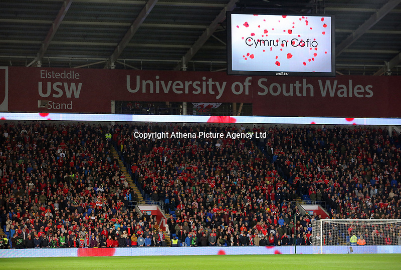 Wales supporters observe a minute's silence for Remembrance Day during the international friendly soccer match between Wales and Panama at Cardiff City Stadium, Cardiff, Wales, UK. Tuesday 14 November 2017.