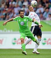 FUSSBALL   1. BUNDESLIGA   SAISON 2011/2012    2. SPIELTAG VfL Wolfsburg - FC Bayern Muenchen      13.08.2011 Hasan SALIHAMIDZIC (li, Wolfsburg) gegen Bastian SCHWEINSTEIGER (re, Bayern)