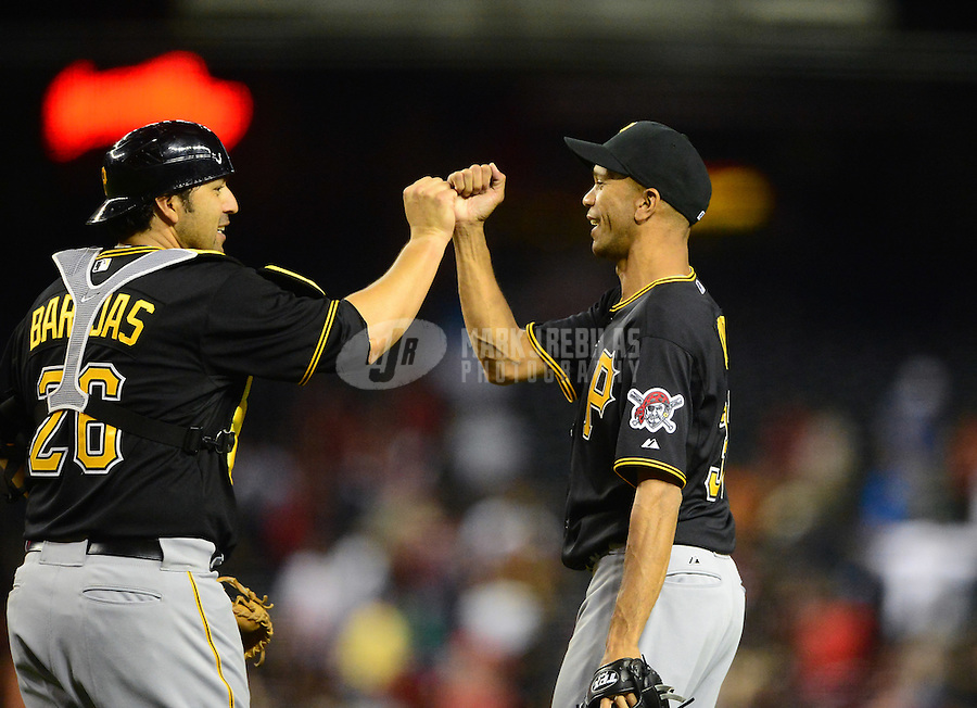 Apr. 17, 2012; Phoenix, AZ, USA; Pittsburgh Pirates pitcher Juan Cruz (right) celebrates with catcher Rod Barajas following the game against the Arizona Diamondbacks at Chase Field. The Pirates defeated the Diamondbacks 5-4. Mandatory Credit: Mark J. Rebilas-