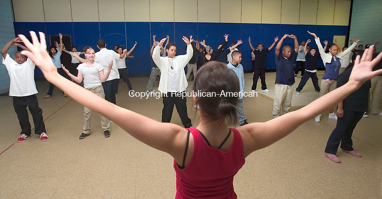WATERBURY, CT. 25 April 2007-042507SV06--Julie Judlova of the Nai Ni Chen Dance Company works on a dance move with Wallace Middle Schoool students during a class at the school in Waterbury Wednesday.<br /> Steven Valenti Republican-American