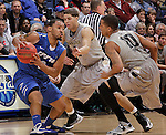 SIOUX FALLS, SD - MARCH 10:  Pierre Bland #2 of IPFW shields the ball from Dante WIlliams #2 and Duke Mondy #10 of Oakland University during their quarterfinal game at the 2013 Summit League Basketball Championships at the Sioux Falls Arena Sunday. (Photo by Dick Carlson/Inertia)