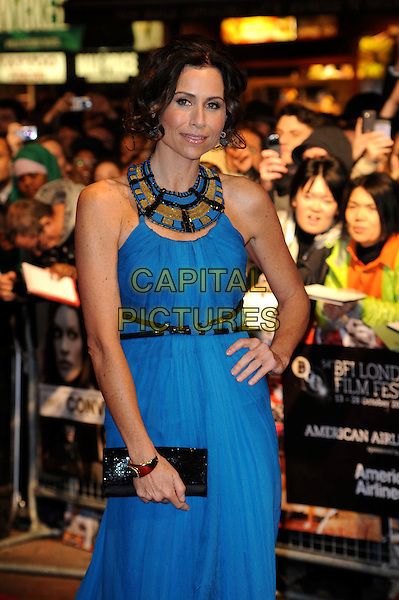 "MINNIE DRIVER.The 54th BFI London Film Festival screening of ""Conviction"" at Vue cinema, Leicester Square, London, England, UK, October 15th 2010 .LFF half length dress blue belt grecian clutch bag sleeveless neckline black gold hand on hip collar .CAP/WIZ.© Wizard/Capital Pictures."