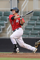 Catcher Jeremy Dowdy (25) of the Kannapolis Intimidators bats in a game against the Charleston RiverDogs on Saturday, June 28, 2014, at CMC-Northeast Stadium in Kannapolis, North Carolina. Kannapolis won, 4-3. (Tom Priddy/Four Seam Images)