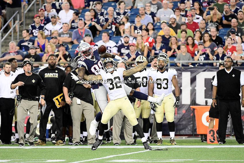 Thursday August 11, 2016: New Orleans Saints strong safety Kenny Vaccaro (32) disrupts a pass to New England Patriots tight end Martellus Bennett (88) during an NFL pre-season game between the New Orleans Saints and the New England Patriots held at Gillette Stadium in Foxborough Massachusetts. The Patriots defeat the Saints 34-22 in regulation time. Eric Canha/CSM