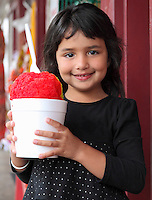 A young local girl with shave ice in Lahaina, Maui.