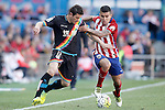 Atletico de Madrid's Angel Correa (r) and Rayo Vallecano's Piti during La Liga match. April 30,2016. (ALTERPHOTOS/Acero)